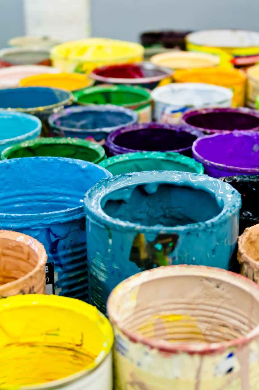 assorted color paint buckets